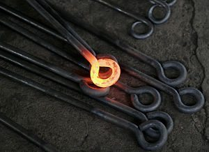 A red-hot iron object, transferring heat to th...